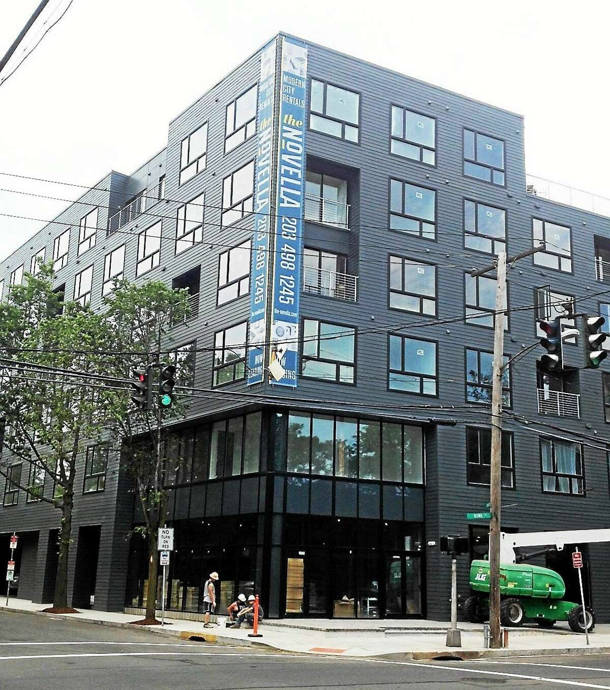 (Mary O'Leary - New Haven Register) A stop work order was issued Monday to subcontractors at the Novella apartments for lack of insurance and payroll paperwork. Developer says it should be cleared up shortly