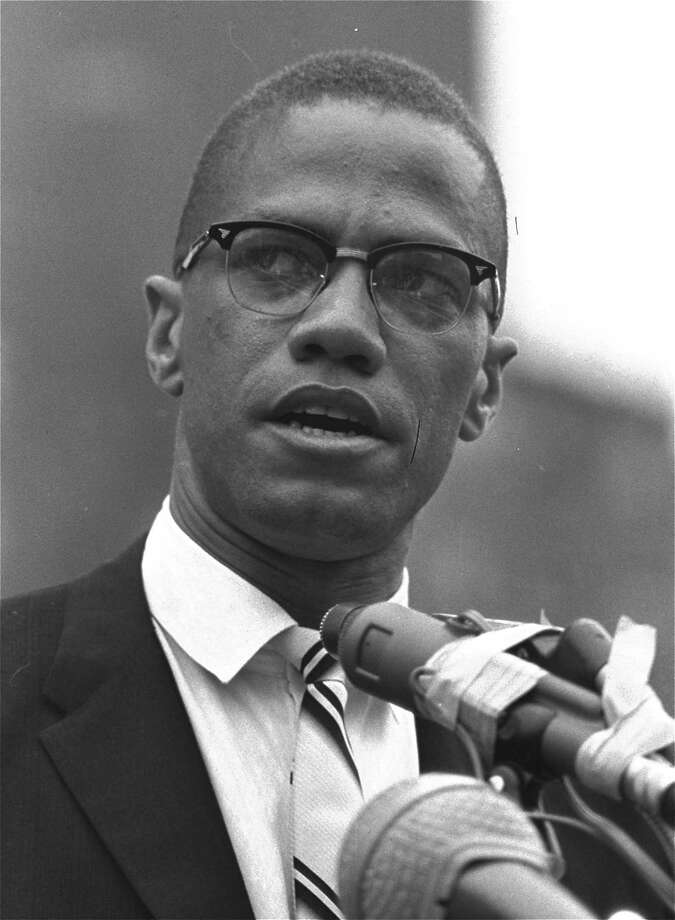 Malcolm X is shown addressing rally in Harlem, New York in this June 29, 1963 file photo. Activists, actors, and politicians are remembering civil rights leader Malcolm X with a ceremony Saturday Feb. 21, 2015 at the New York site in Harlem where he was killed 50 years ago. (AP Photo/File) Photo: AP / AP
