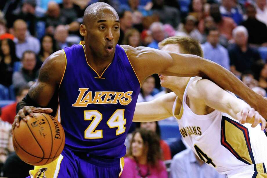 Los Angeles Lakers guard Kobe Bryant drives against Pelicans guard Nate Wolters during the first half of Wednesday's game in New Orleans. Photo: Jonathan Bachman — The Associated Press   / FR170615 AP