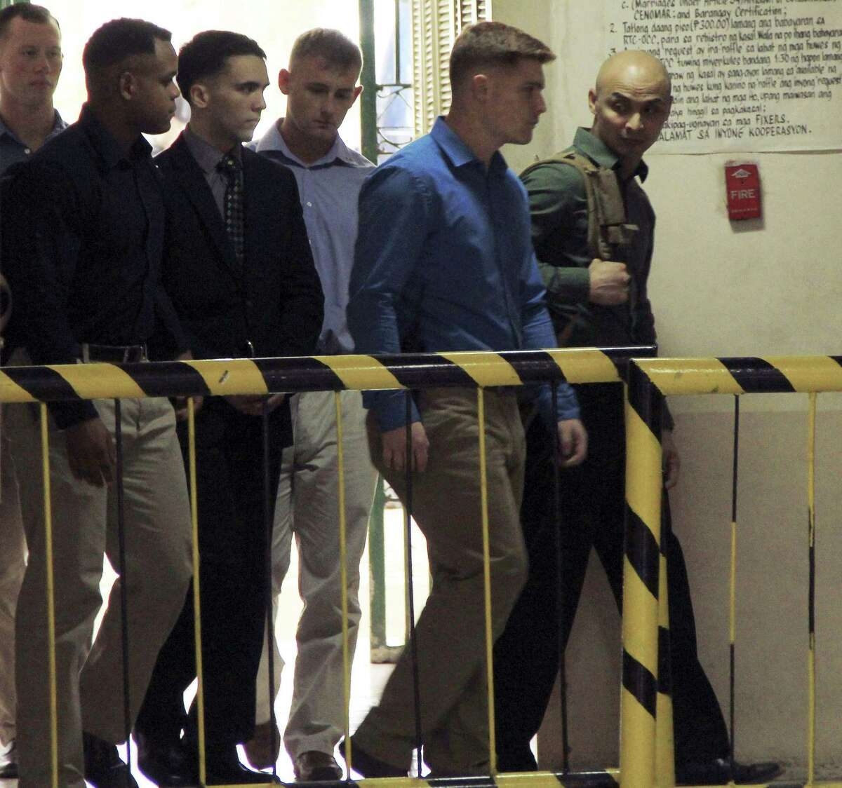 "U.S. Marine Pfc. Joseph Scott Pemberton, third left, the suspect in the Oct.11, 2014 killing of Filipino transgender Jennifer Laude at the former U.S. naval base of Subic, northwest of Manila, is escorted into the courtroom for his scheduled trial March 23, 2015 at Olongapo city, Zambales province, northwest of Manila, Philippines. Pemberton was tagged as the suspect in the killing which the protesters termed as a ""hate crime"" against LGBT (Lesbian, Gay, Bisexual and Transgender) Filipinos."