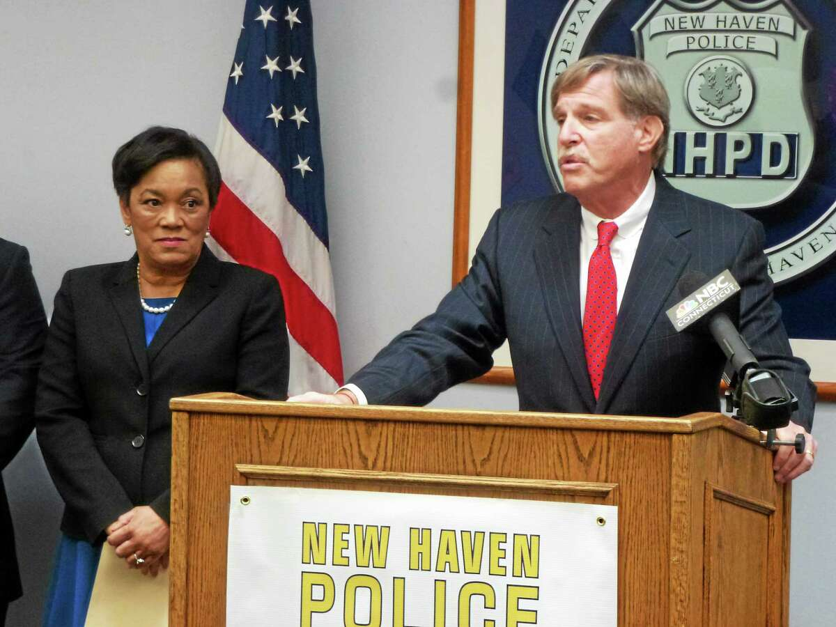 New Haven Police Foundation Chairman Richard Epstein speaks about the new organization. At left is Mayor Toni N. Harp.