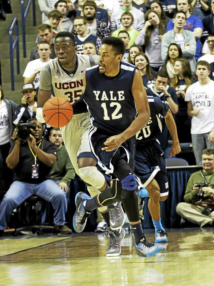 Yale senior Armani Cotton is hoping to pass along the importance of playing smart basketball — and being a solid student — in the basketball clinic he started after he graduated from high school. Photo: Photo Courtesy Of Steve Musco — Yale Athletics   / Steve Musco