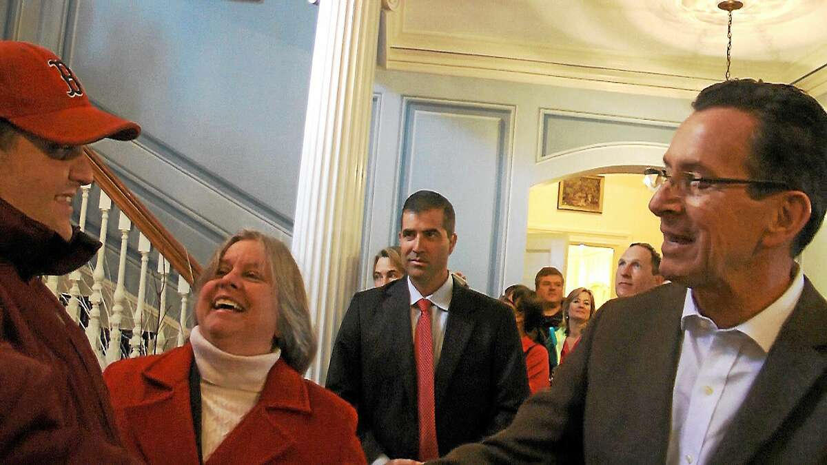 CONTRIBUTED PHOTO Robert Embardo, left, and his mother, Peggy Embardo, center, meet Gov. Dannel Malloy at an open house at the governor's mansion.