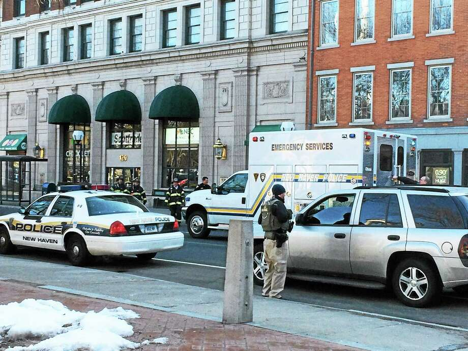 Two suspicious packages on the steps of the federal courthouse at 141 Church St. in New Haven shut down part of the road near City Hall during the morning rush hour Monday. The packages reportedly contained envelopes. Photo: Wes Duplantier -- New Haven Register