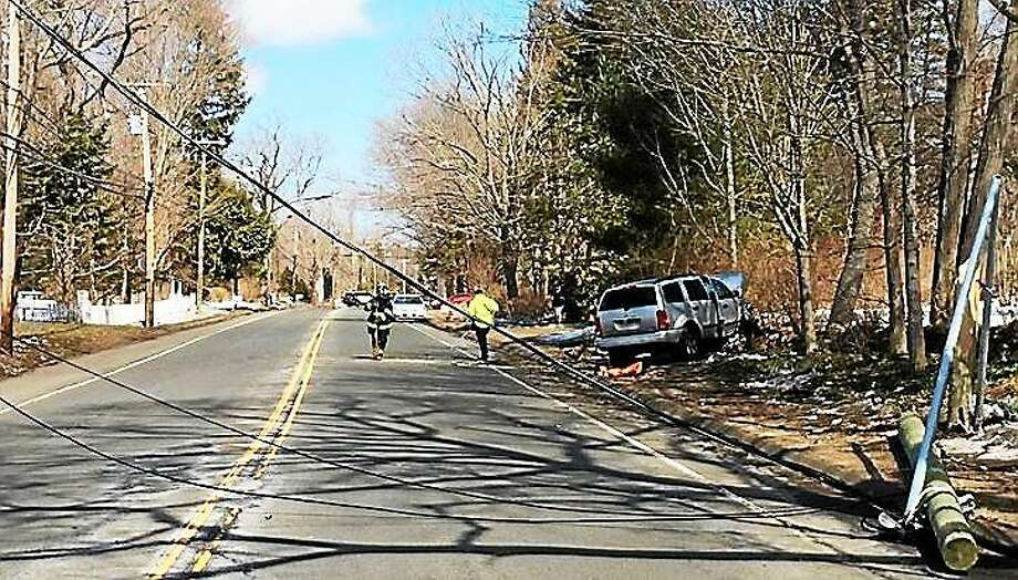 One person was taken to the hospital and part of Whitney Avenue was blocked late Sunday morning after an SUV hit a utility pole and a tree. Photo: Photo From Hamden Professional Firefighters Local 2687.