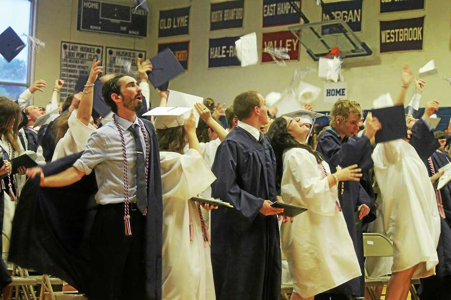 The Morgan School graduates toss their caps into the air Tuesday, June 23, 2015. Photo: Valerie Bannister - Special To The Register