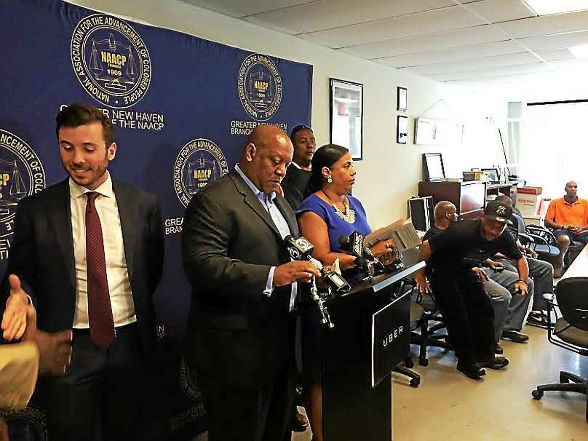 Matt Powers, general manager of Uber Connecticut (at left) joins Connecticut NAACP President Scott X. Esdaile (center) and Doris Dumas, president of the organization's Greater New Haven Branch, announce the launch of UberUp in the city and around the state. Uber hopes to recruit 1,500 drivers by the end of the year from Connecticut's urban centers.