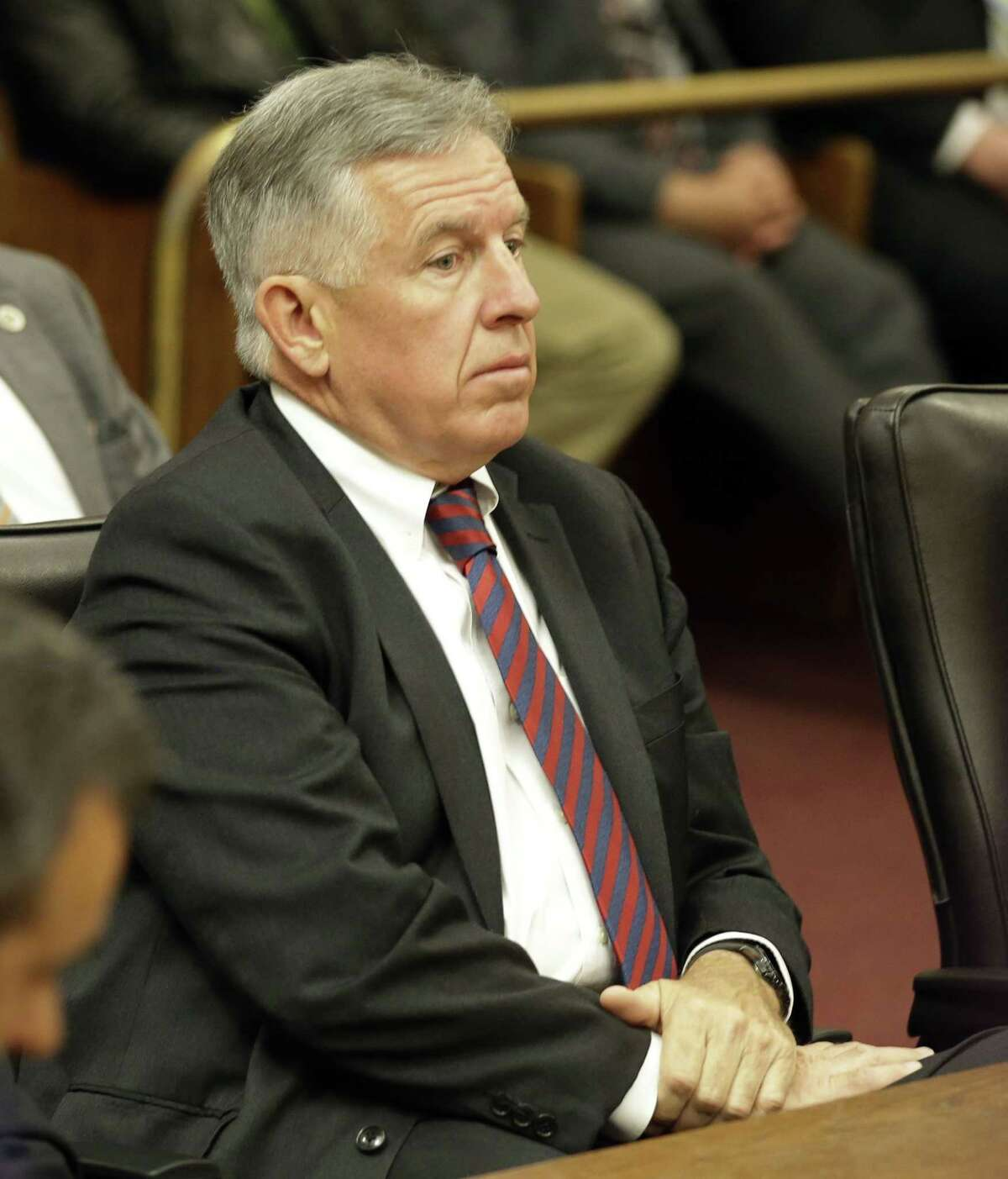 Cuyahoga County Prosecutor Timothy J. McGinty listens as the judge reads the verdict in the Michael Brelo case Saturday, May 23, 2015, in Cleveland. Brelo, a patrolman charged in the shooting deaths of two unarmed suspects during a 137-shot barrage of gunfire was acquitted Saturday in a case that helped prompt the U.S. Department of Justice determine the city police department had a history of using excessive force and violating civil rights. (AP Photo/Tony Dejak)