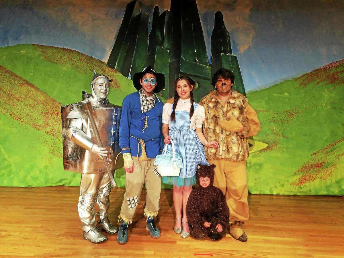 """Eddie Varipapa '15, Dom Pagliaro '16, Kayla Hansen '15 (Sacred Heart Academy), Vin Crotta '15, William Bader and the rest of the cast and crew of the """"Wonderful Wizard of Oz"""" put on three Notre Dame of West Haven Drama Club shows."""