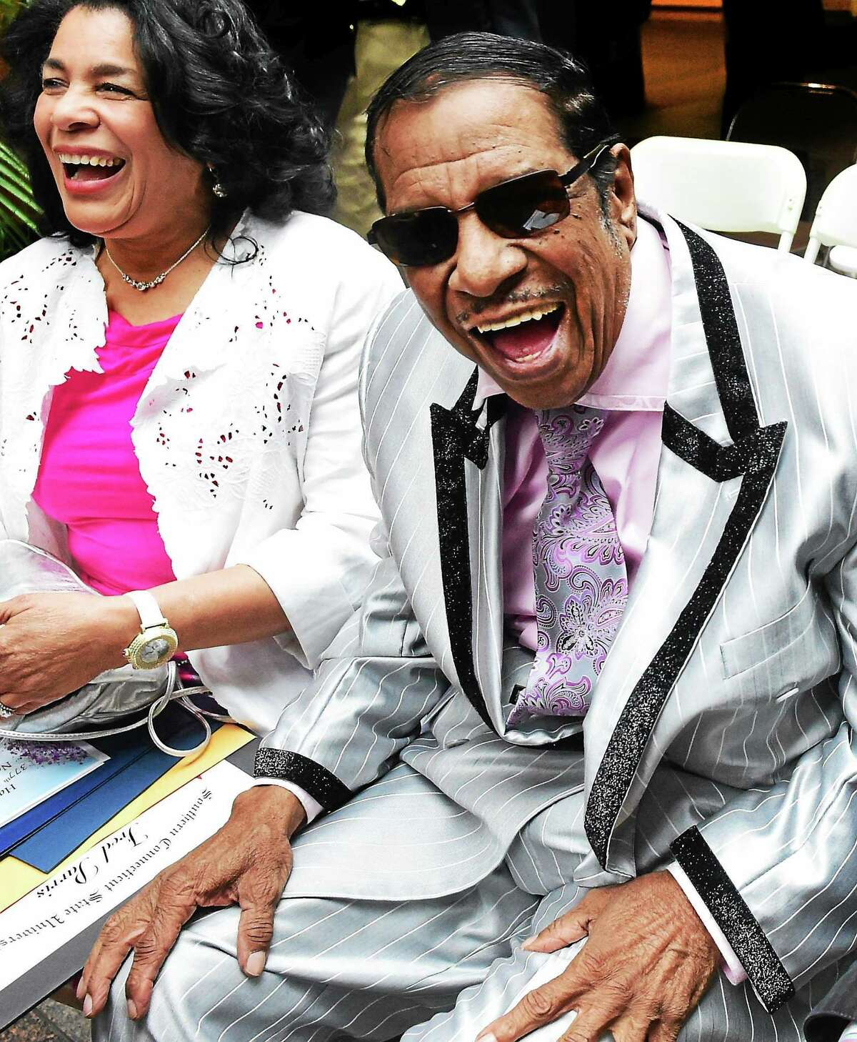 Fred Parris of the Five Satins, right, and his wife, Emma Parris, laugh with well-wishers after tribute to him and the Five Satins at a City Hall ceremony Thursday to commemorate the city's 377th birthday.