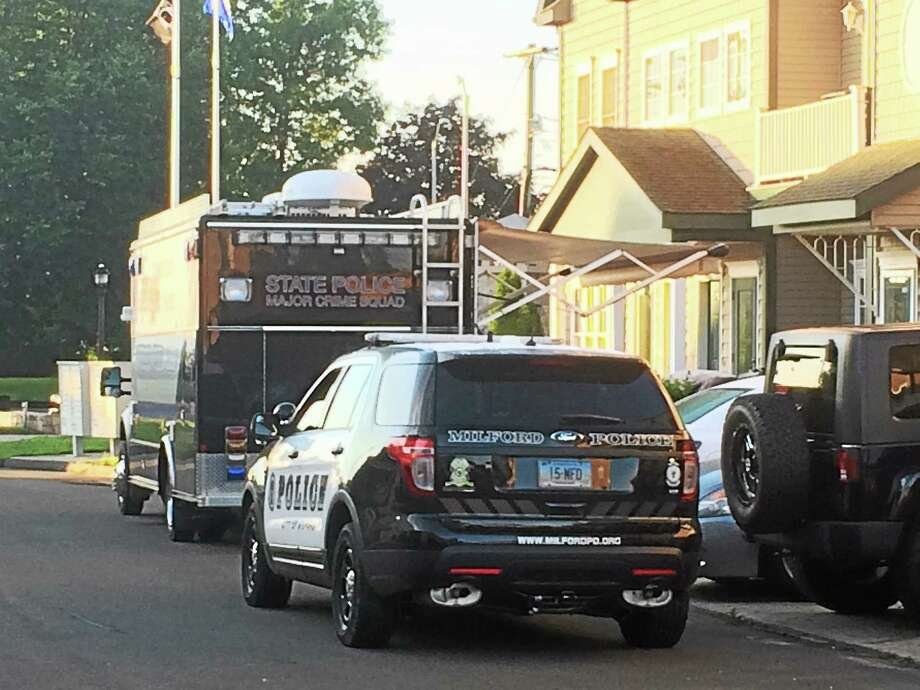 Connecticut State and Milford police investigated the death of Milford Police Officer Michael Compare at a Naugatuck Avenue condominium on Monday, June 22, 2015. Photo: Wes Duplantier--New Haven Register
