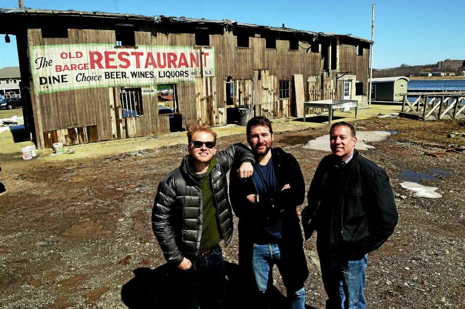 From left, Miles Pincus, brother Alexander Pincus and local historian Robert Greenberg by the skeleton of the shuttered Old Barge Restaurant on Front Street in New Haven. Photo: Peter Hvizdak — New Haven Register   / ©2015 Peter Hvizdak