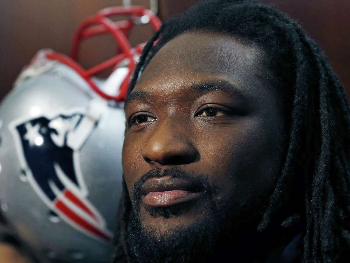 New England Patriots running back LeGarrette Blount listens to a reporter's question at his locker prior to practice Thursday in Foxborough, Mass.