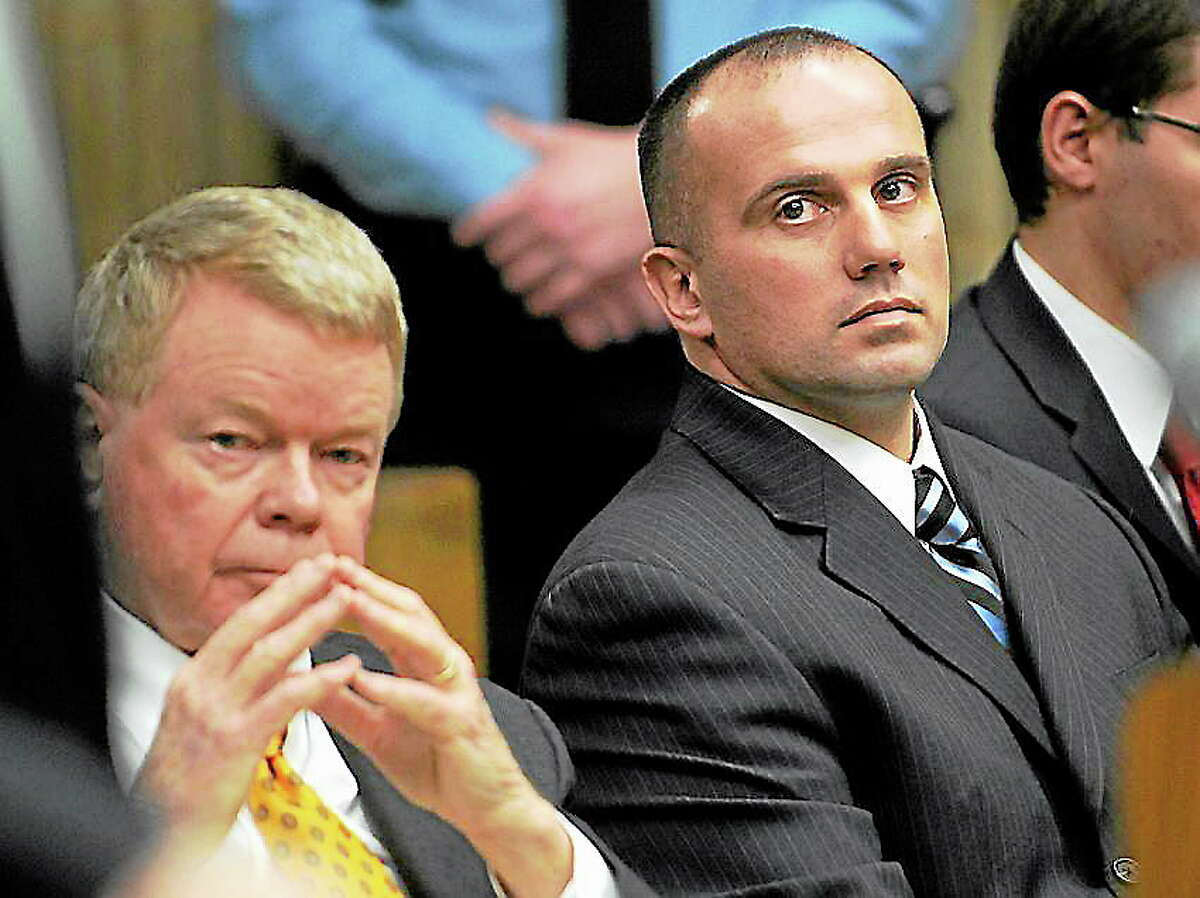 Sitting with his attorney, Hugh F. Keefe, left, former Milford police Officer Jason Anderson listens during sentencing proceedings at Superior Court in Milford on Jan. 16, 2013.