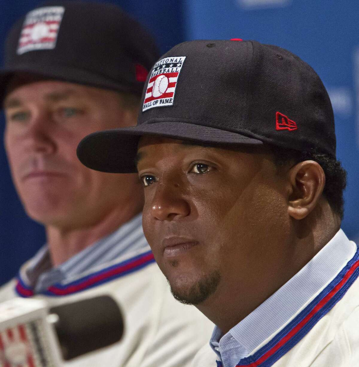National Baseball Hall of Fame inductee Pedro Martinez, right, will be wearing a Boston Red Sox cap on his plaque in Coopertown.