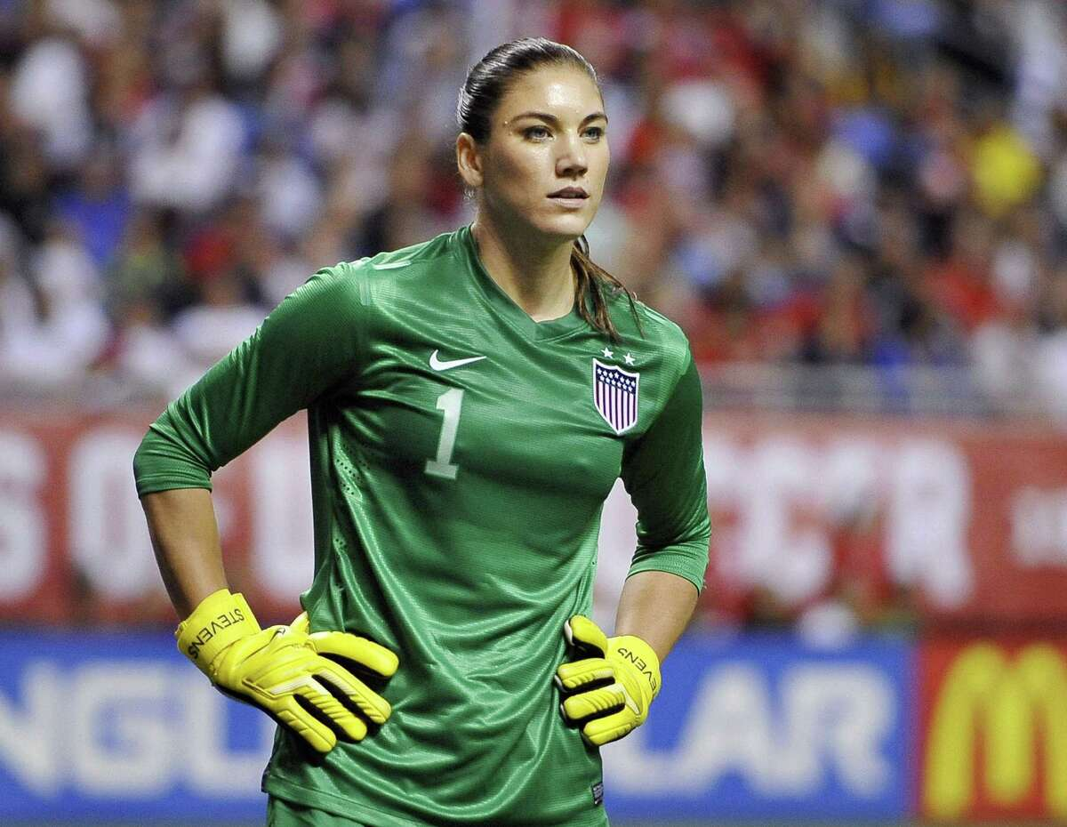In this Oct. 20, 2013 file photo, United States goalkeeper Hope Solo competes in an international friendly against Australia in San Antonio.