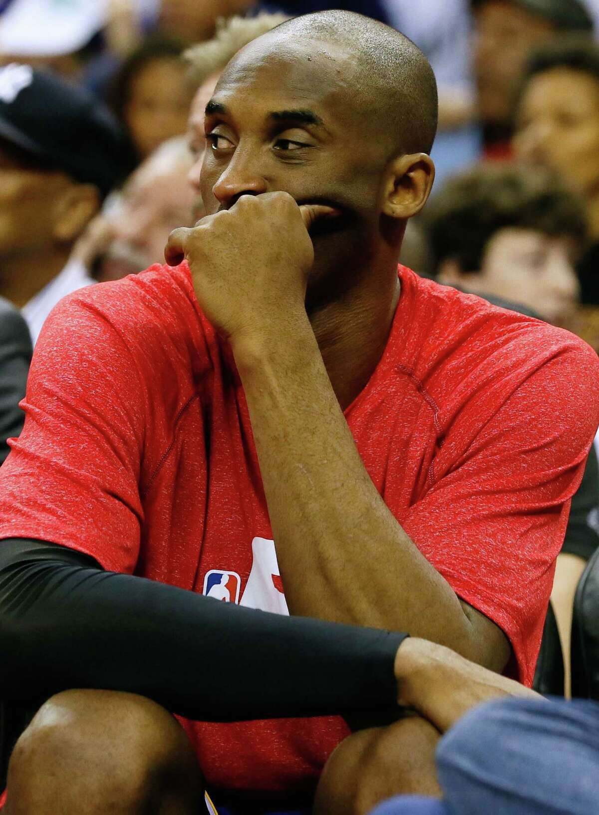 Los Angeles Lakers guard Kobe Bryant reacts from the bench during the first half of a game against the Pelicans on Wednesday in New Orleans.