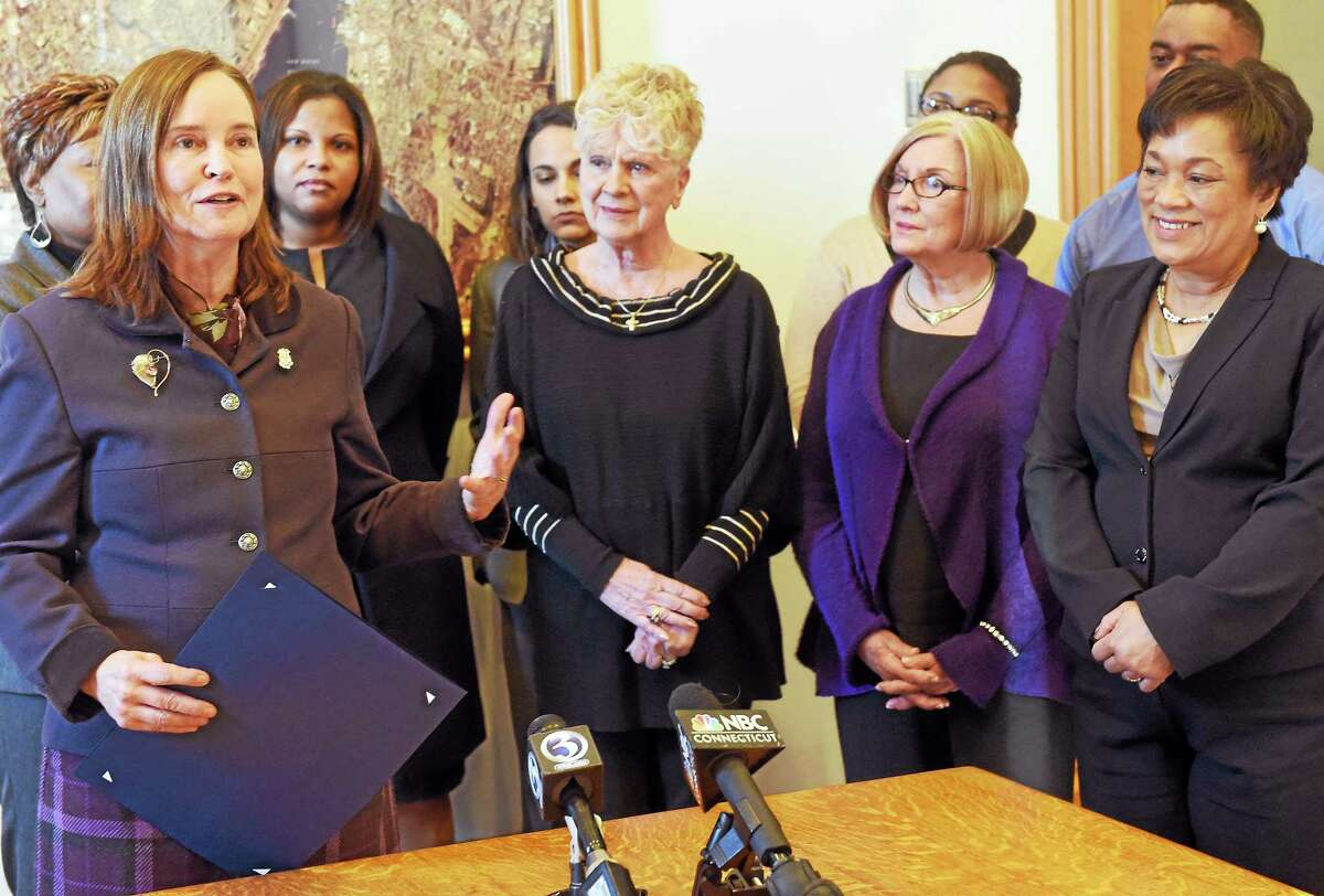 Connecticut Secretary of the State Denise Merrill, far left, presents a citation to the city of New Haven Friday in recognition of the city successfully accommodating more than 600 Election Day voter registrations. Mayor Toni Harp is at far right.