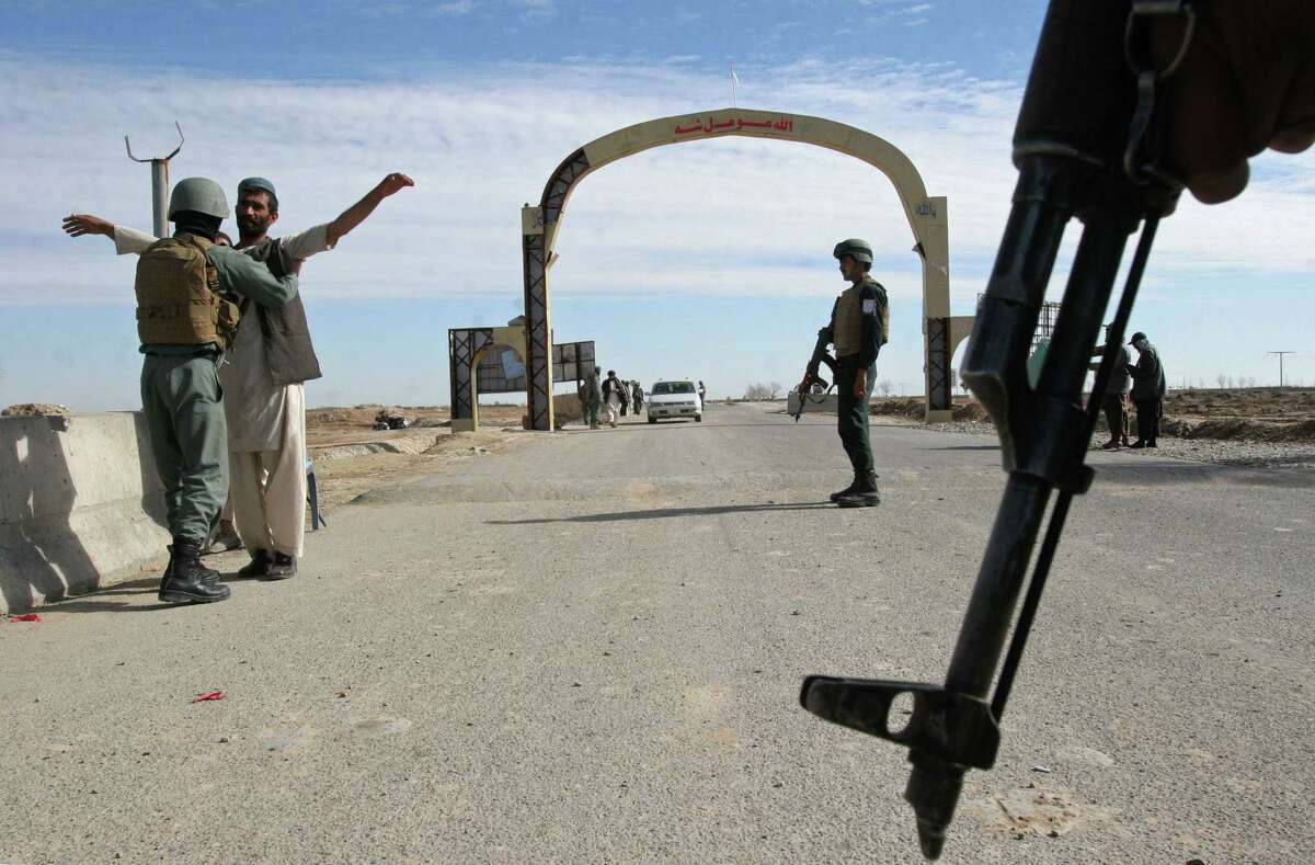 AP Photo/Abdul Khaliq, File In this Feb. 26, 2015 photo, Afghan security police stand guard at checkpoint in Helmand province, south of Kabul, Afghanistan.