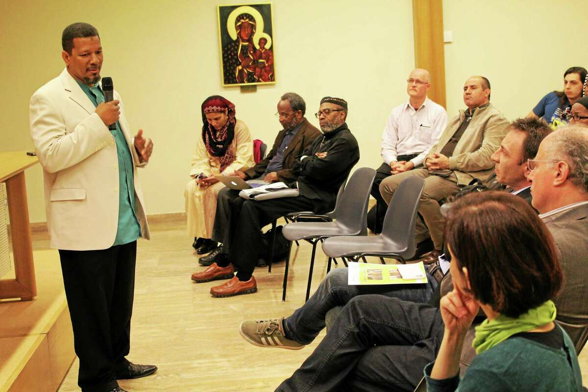 Imam Talib Shareef, leader of The Nation's Mosque in Washington, D.C. is photographed addressing the international body of the Focolare Movement on the unity of religions.