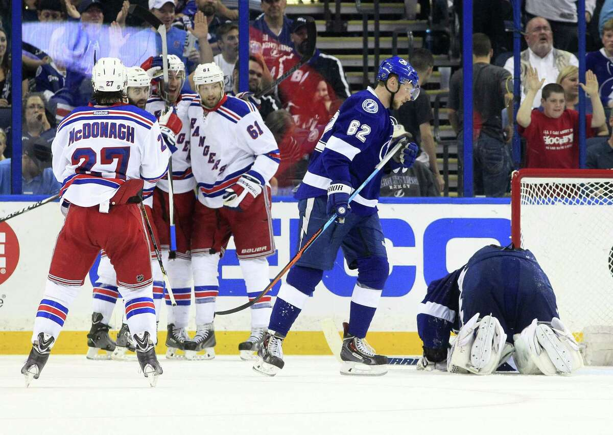 The New York Rangers celebrate a goal scored by left wing Rick Nash (61) against Tampa Bay Lightning goalie Ben Bishop, right, during the third period of Game 4 Friday. The Rangers won 5-1.