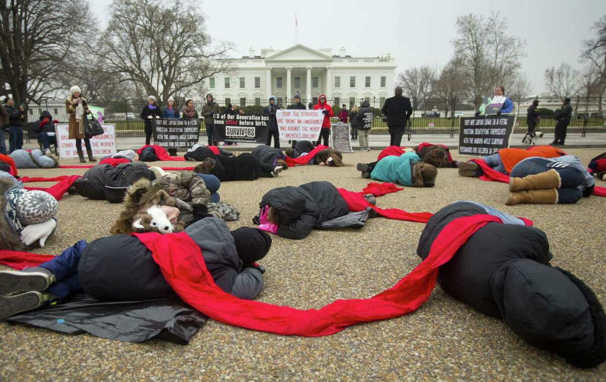 """Anti-abortion activists stage a """"die-in"""" in front of the White House in Washington on Jan. 21, 2015. Thursday marks the 42nd anniversary of the U.S. Supreme Court's Roe v. Wade decision in 1973 that established a nationwide right to abortion."""