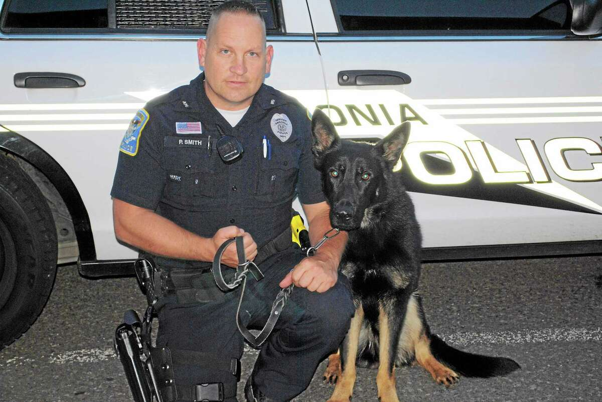Officer Paul Smith and Kane, a K9 who will be starting work with the Ansonia Police Department after completing three months of training.