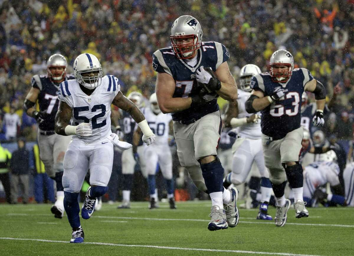 In this Jan. 18 file photo, New England Patriots tackle Nate Solder makes a touchdown reception during the second half of the AFC championship game against the Indianapolis Colts in Foxborough, Mass.