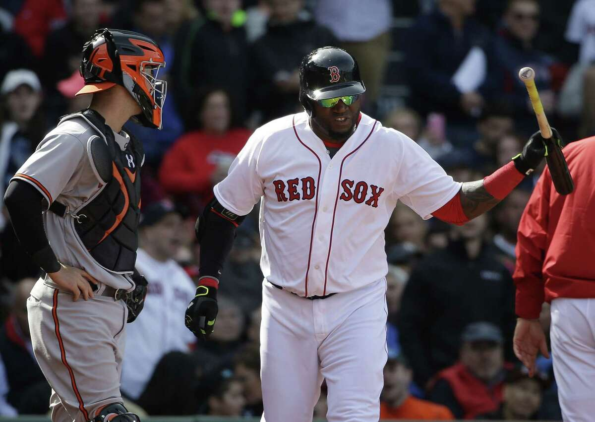 Red Sox DH David Ortiz throws his bat after being ejected from Sunday's game against the Baltimore Orioles in Boston.