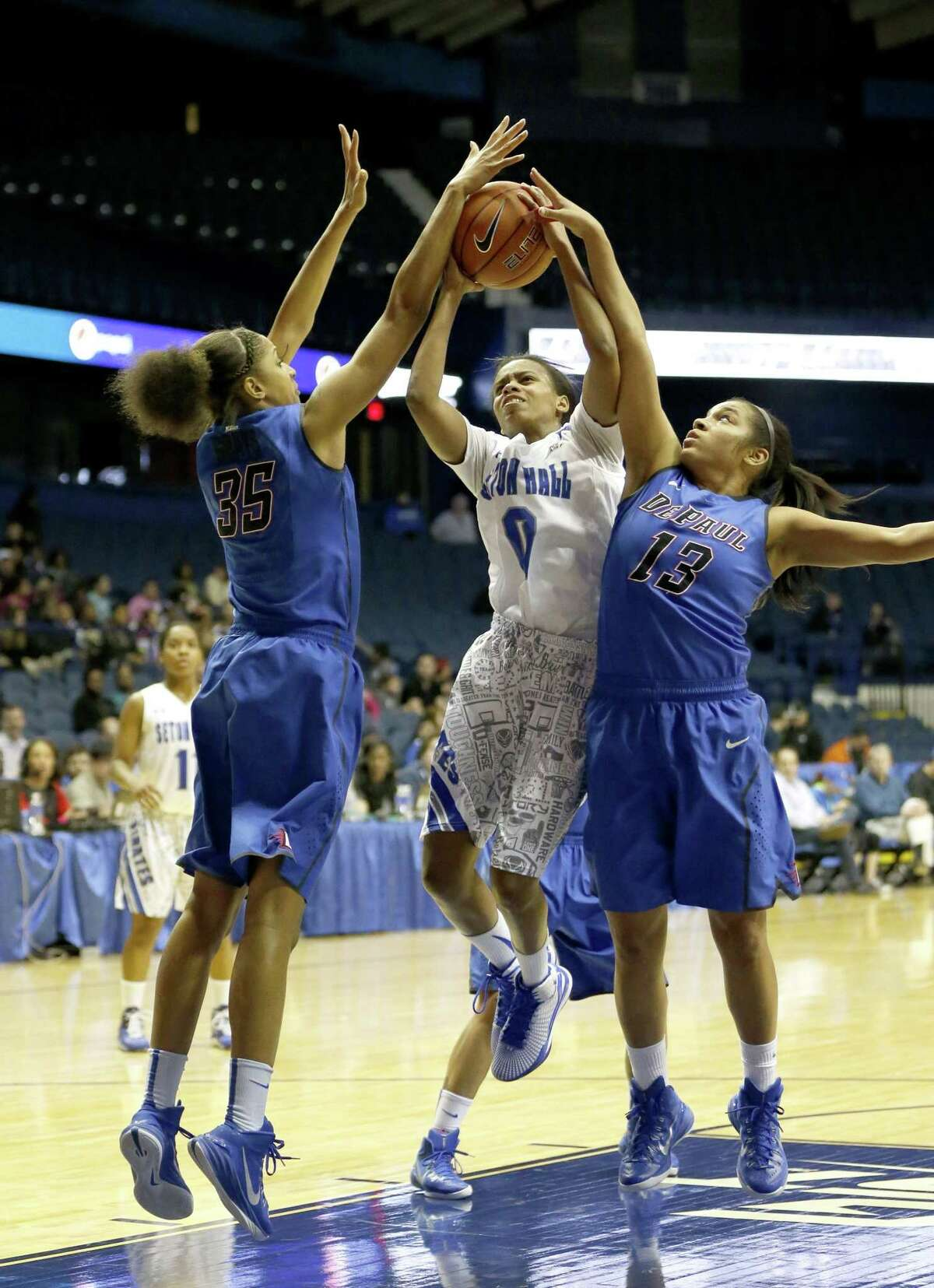 Seton Hall guard Daisha Simmons drives between DePaul's Mart'e Grays (35) and Chanise Jenkins during the Big East tournament title game on March 10 in Rosemont, Ill.