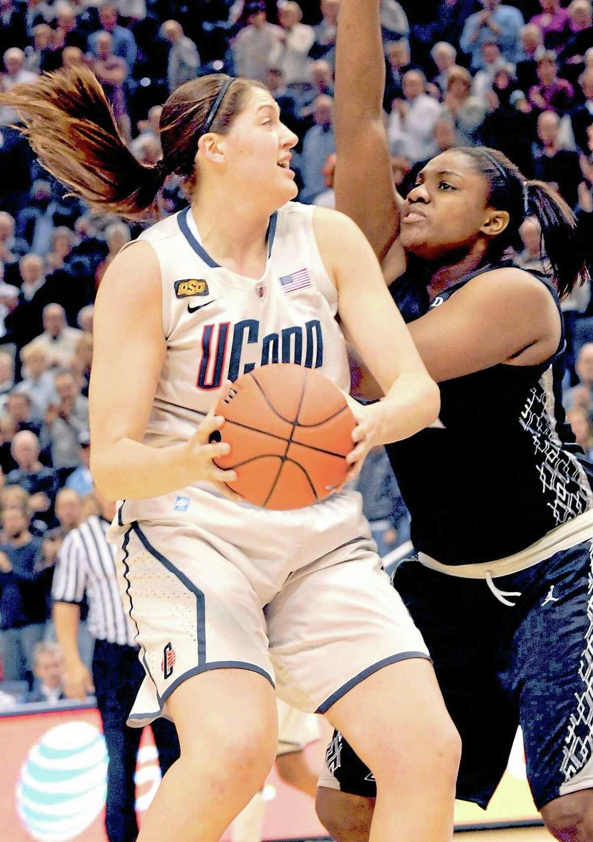 Hamden native and Hopkins grad Lauren Okafor defends UConn's Stefanie Dolson during a 2012 game in Hartford.