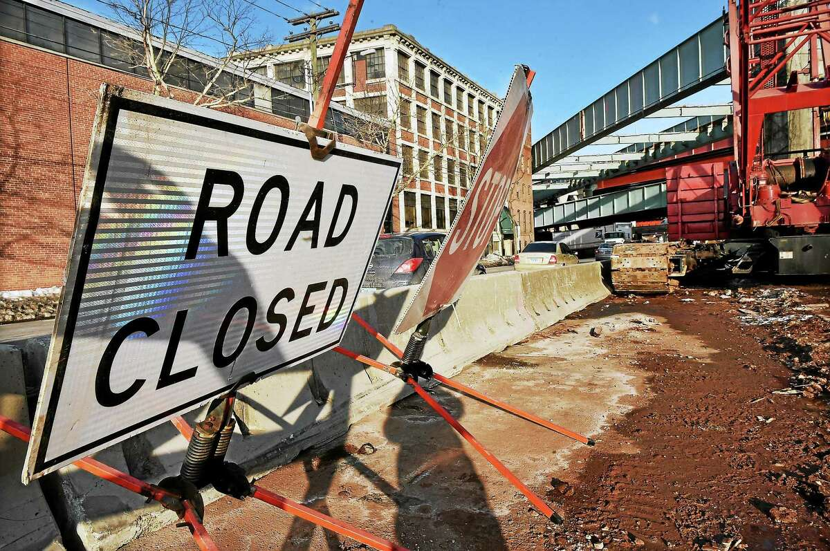 The bridge over Water Street in New Haven, top right, will be removed this weekend.