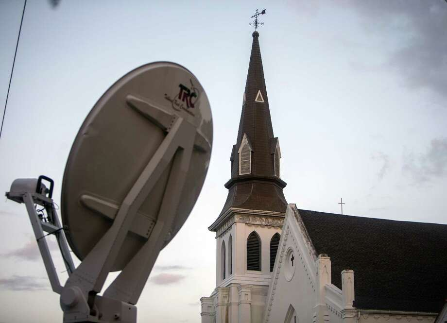 A media satellite dish points to the sky in front of the Emanuel AME Church Sunday, June 21, 2015, before the first worship service since nine people were fatally shot at the church during a Bible study group, in Charleston, S.C. Photo: AP Photo/Stephen B. Morton   / FR56856 AP