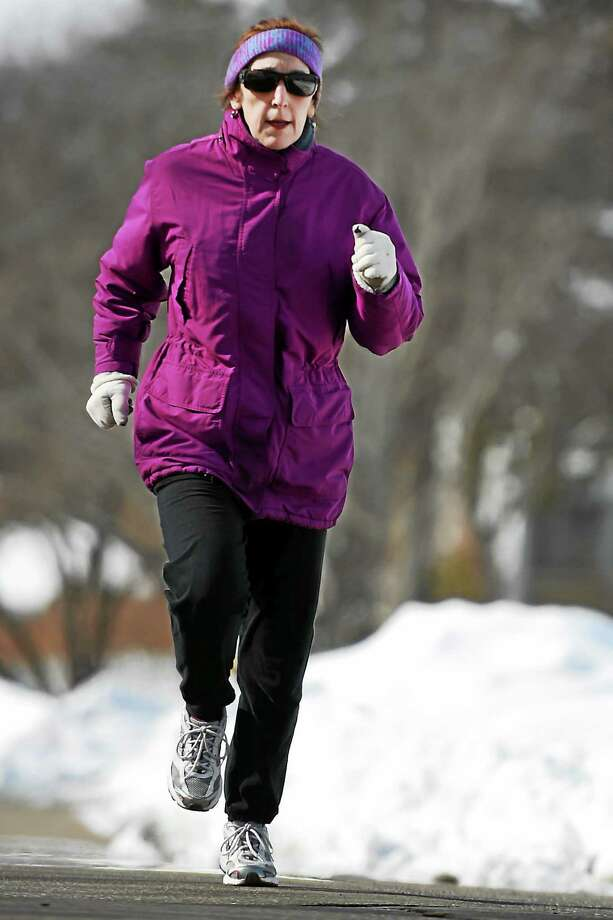 """Branford resident Lisa Reisman, tri-athlete, writer, author, will do a number of book appearances in support of """"5 Months, 10 years, 2 Hours."""" Photo: Peter Hvizdak - New Haven Register   / ?2015 Peter Hvizdak"""