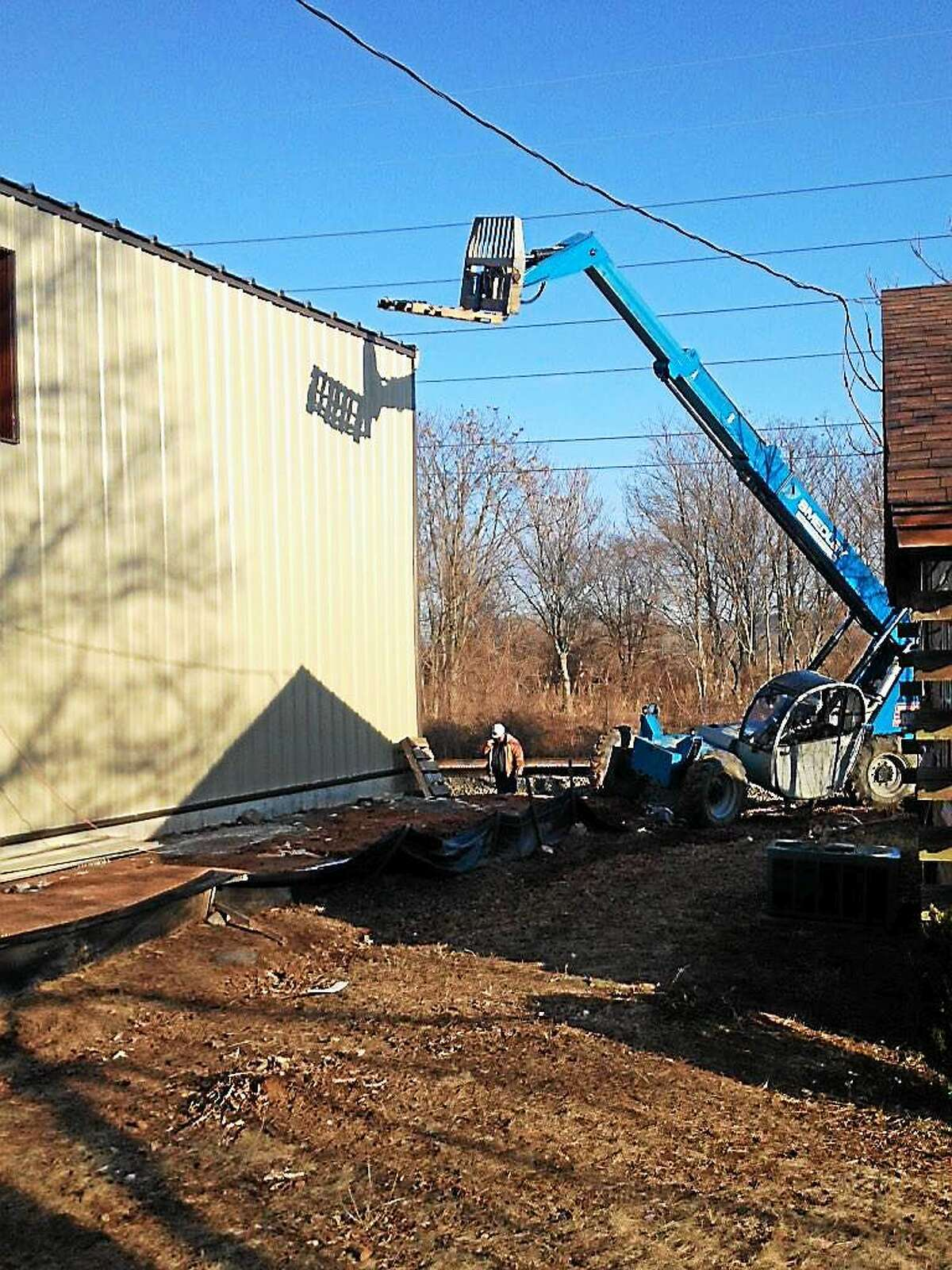 Three men were injured after falling from an aerial lift at a construction site at 2335 State St. in Hamden.