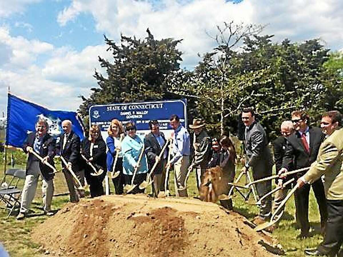 Gov. Dannel P. Malloy, seventh from left, and other officials break ground at Hammonasset Beach State Park, which will get an $11.5 million makeover.