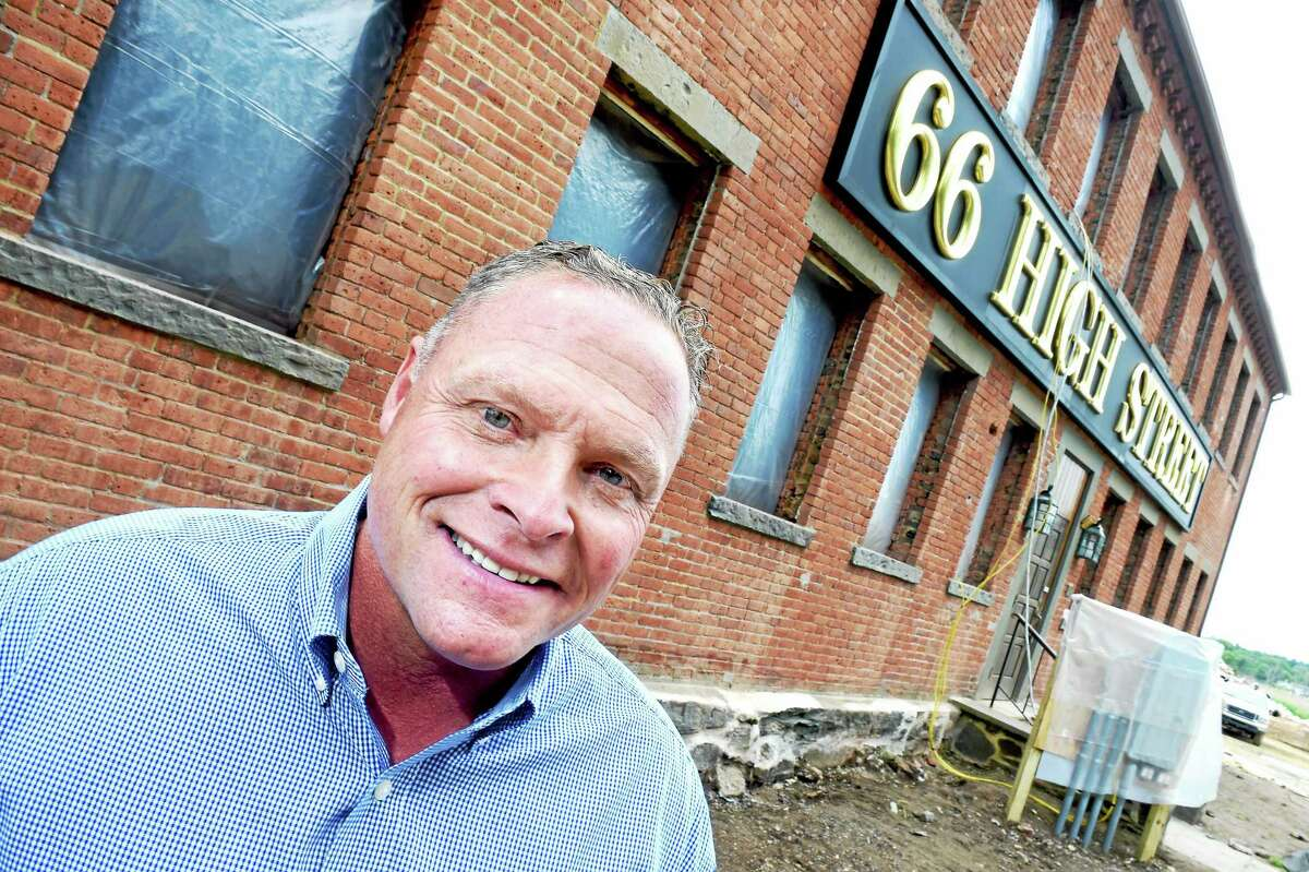 Kenny Horton, owner of Residences at 66 High Street, is photographed on 6/5/2015 in front of a factory built in 1884 being converted into luxury condominiums in Guilford.