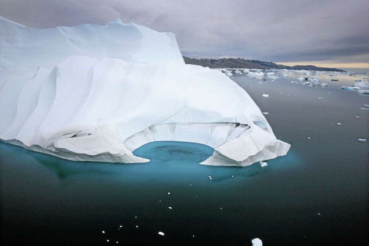In this July 19, 2007, file photo, an iceberg melts off the coast of Ammasalik, Greenland.