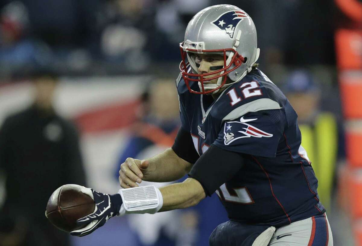 New England Patriots quarterback Tom Brady hands the ball off during the first half of Sunday's AFC championship game against the Indianapolis Colts in Foxborough, Mass.