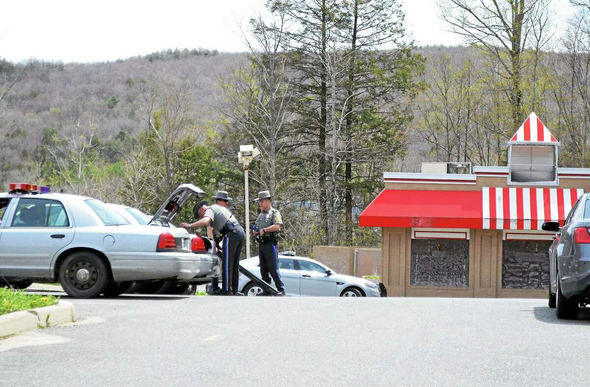 State police gather evidence at the vacant KFC restaurant on Main Street in Winsted, where shooting suspect Scott Gellatly was apprehended May 7, 2014.