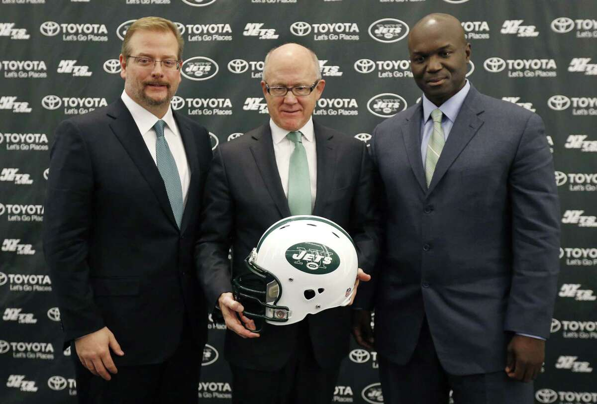 New York Jets owner Woody Johnson, center, poses for photographers with the team's new general manager Mike Maccagnan, left, and new head coach Todd Bowles during a Wednesday press conference in Florham Park, N.J.