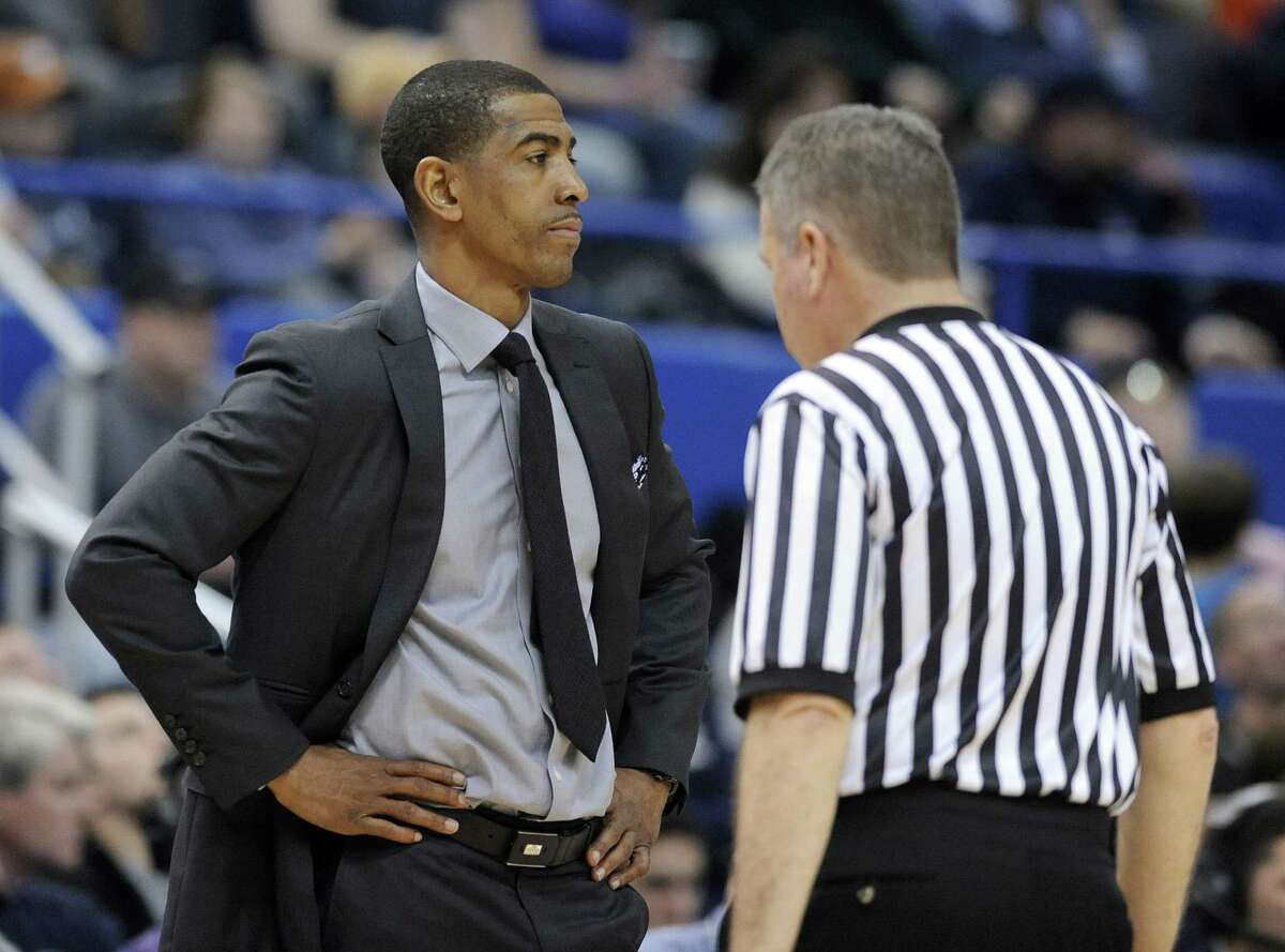 UConn head coach Kevin Ollie reacts to a call during the second half of the Huskies' win over Cincinnati on Jan. 10 in Hartford.