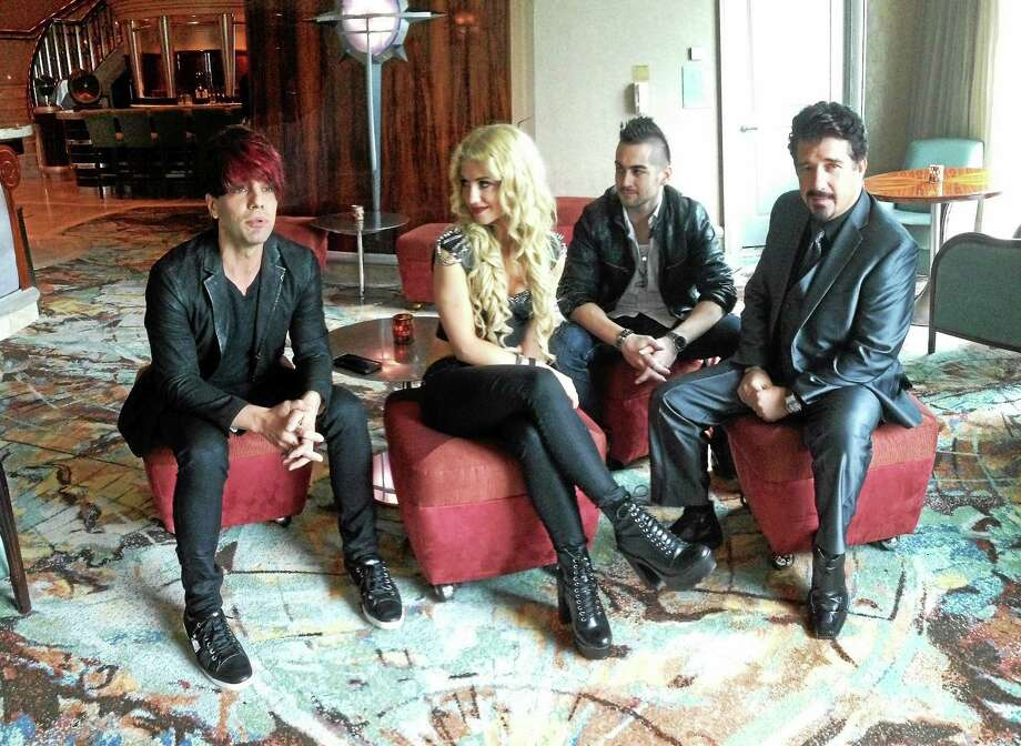 Criss Angel, left, with Krystyn, Landon Swank and Banachek in a lounge at Paragon restaurant in the Grand Pequot Hotel at Foxwoods. Photo: Joe Amarante — New Haven Register