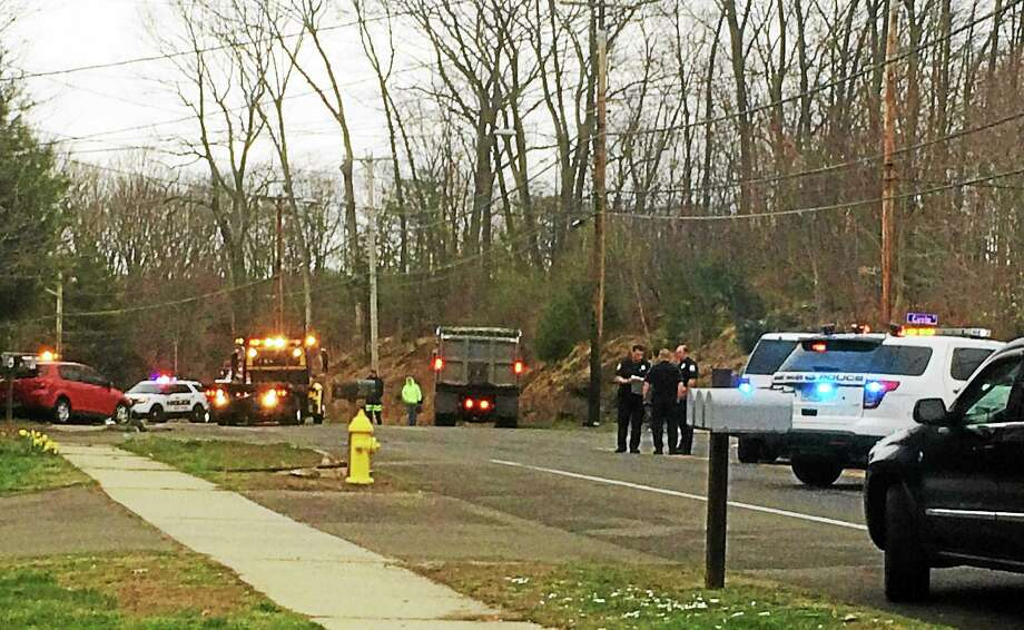 A crash involving a dump truck and at least one other vehicle prompted East Haven police to shut down part of Foxon Road for about an hour during the Monday morning rush. Photo: (Wes Duplantier -- New Haven Register)