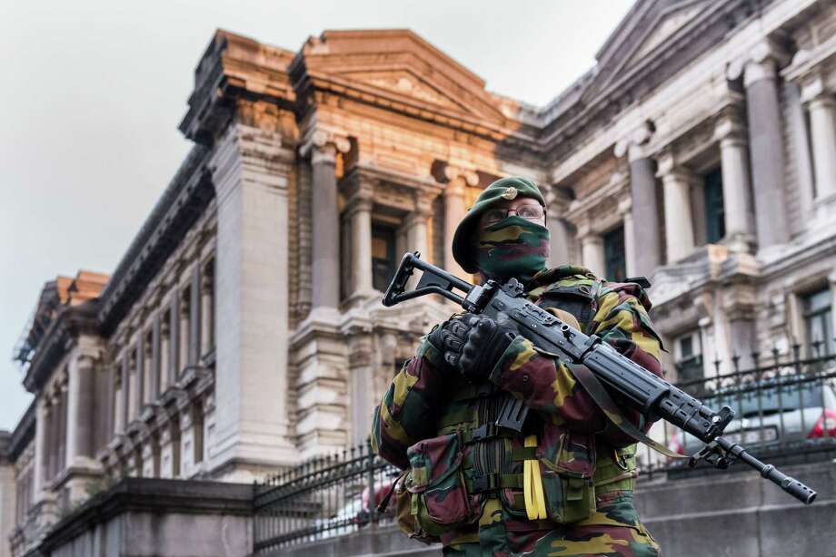 A Belgian security officer stands guard near the Palace of Justice, where suspects wanted in Belgium on terrorism-related charges are set to appear before the federal court, in Brussels on Wednesday, Jan. 21, 2015. The suspects were picked up in an anti-terror sweep following a firefight in Verviers, in which two suspected terrorists were killed. (AP Photo/Geert Vanden Wijngaert) Photo: AP / AP
