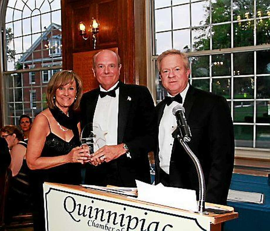 CONTRIBUTED PHOTO  From left, Dee Prior Nesti, executive director of the Quinnipiac Chamber of Commerce; Chris Ulbrich, CEO of Ulbrich Stainless Steels; and Tom Curtin, corporate director, Human Resources, at the Centennial Celebration Gala. Photo: Journal Register Co.