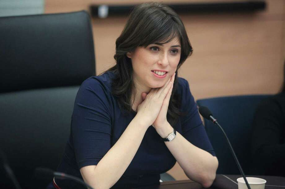 In this photo taken March 13, 2012, Knesset member Tzipi Hotovely sits in the Knesset, Israel's parliament, in Jerusalem. on Thursday, May 21, 2015 Hotovely, Israelís new deputy foreign minister, delivered a defiant message to the international community on Thursday, May 21, 2015, saying that Israel owes no apologies for its policies in the Holy Land and citing religious texts that it belongs to the Jewish people. (AP Photo/Emil Salman) Photo: AP / AP