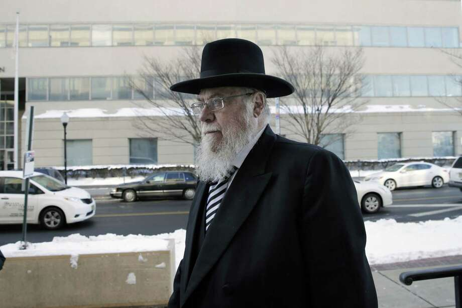Rabbi Mendel Epstein, right, arrives for his trial at federal court in Trenton, N.J. on Wednesday, Feb. 18, 2015. Prosecutors say Epstein employed a kidnap team to force unwilling Jewish husbands to divorce their wives. (AP Photo/Mel Evans) Photo: AP / AP