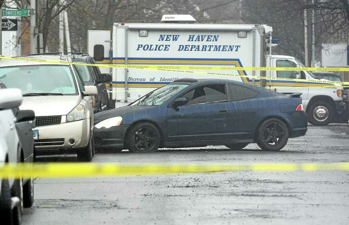 A car crashed near Orchard Place and Charles Street Monday afternoon, after police say the driver was shot several times nearby.