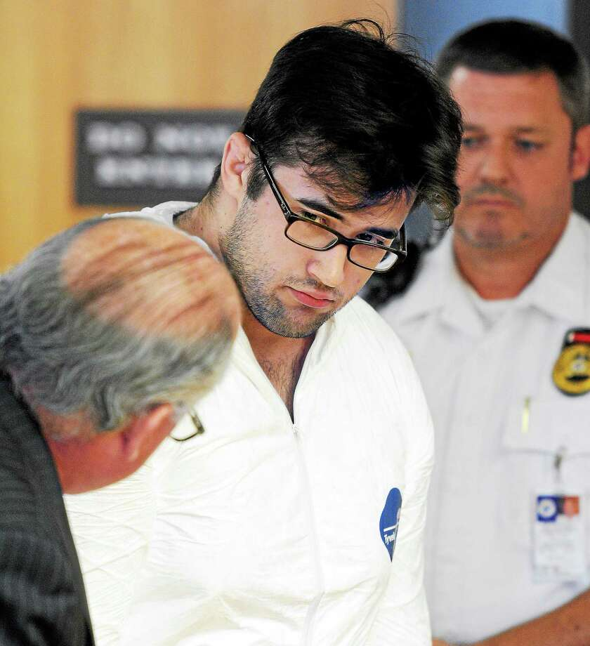 Timothy Granata, center, is arraigned in the killing of his mother, Claudia Granata, in Superior Court in Derby in July 2014. Photo: Arnold Gold — New Haven Register